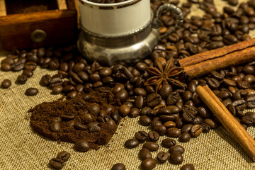 retro wooden manual coffee grinder coffee beans and a glass on a vintage tablecloth, heart-shaped ground coffee