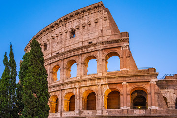 Rome, Italy - External walls of the ancient roman Colosseum - Colosseo - known also as Flavian amphitheater - Anfiteatro Flavio - in an evening light