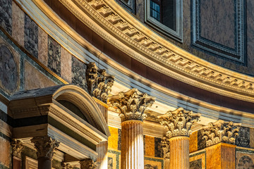 Rome, Italy - Interior of Roman Pantheon ancient temple, presently catholic Basilica, with its reach decorations, arches and colonnades covered with golden and colorful paintings