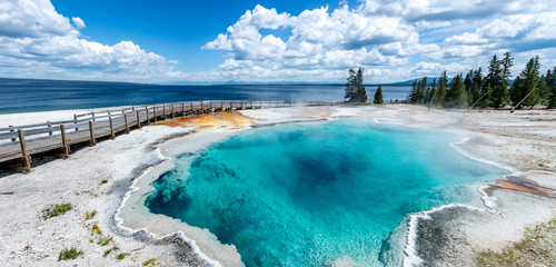panoramic picture of blue water hot spring (black pool) in yellowstone national park