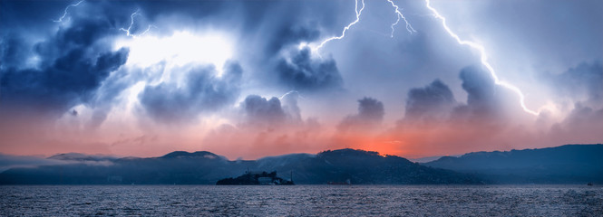 Panoramic view of Alcatraz Island and San Francisco coastline during a storm, California, USA