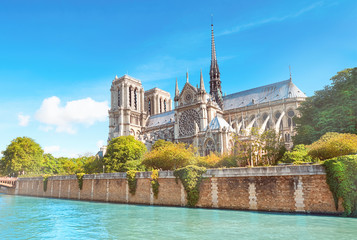 Undamaged east facade of Notre Dame de Paris in Springtime before the fire. Seasonal Spring travel background, panoramic image, panorama of undamaged famous French landmark reflected in river Seine.