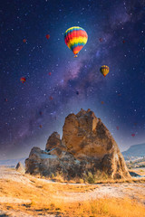 Colorful hot air balloons flying over at fairy chimneys in Nevsehir, Goreme, Cappadocia Turkey. Hot air balloon flight at spectacular Cappadocia Turkey.