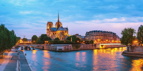 Paris France, panorama city skyline night at Notre Dame de Paris Cathedral and Seine River