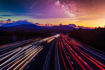 busy night traffic on the highway.light trace from the cars and starry night