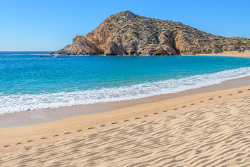 Santa Maria Beach, Cabo San Lucas, Mexico. Different stages of the fantastic ocean waves. Rocky and sandy beach.