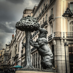 Grey sky over famous Bear and Strawberry tree statue in Madrid