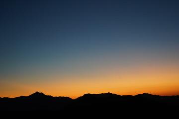 Orange Sunset Sinking in Mountain