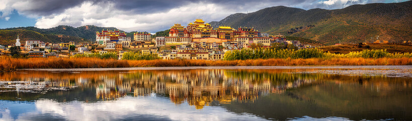 Panorama scene of Songzanlin Temple, is Tibetan Buddhist monastery in Zhongdian city, Shangri-La, Yunnan province, China, travel and tourists,famous place and landmark,religious and holiday concept