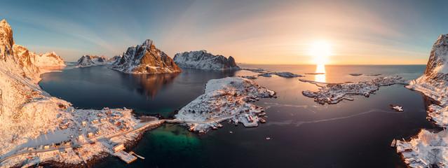 Sunrise on Lofoten island is archipelago with fishing village on coastline in winter at Norway