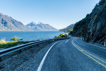 Winding road at lake and mountains New Zealand