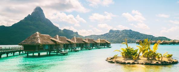 Bora Bora French Polynesia luxury hotel resort overwater bungalow suites in Tahiti, Honeymoon travel destination header panorama background.