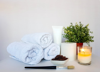 Relaxing pampering in a spa salon on a white background.