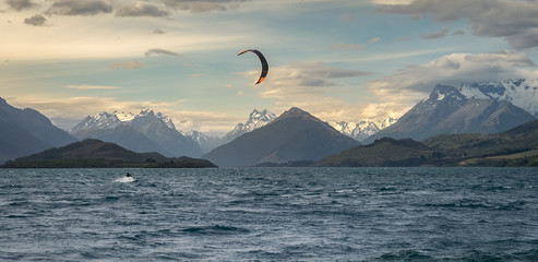 Kite surfer on Lake Wakatipu in New Zealand between Queenstown and Glenorchy.