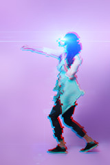 Woman is using virtual reality headset. Image with glitch effect.