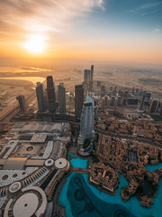 Aerial top view of Dubai famous fountains pool from above in morning from highest tower in world.
