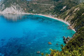 Myrtos beach. Clear azure blue sea water in beautiful bay. Favorite tourist visiting destination place at summer on Kefalonia island, Greece, Europe
