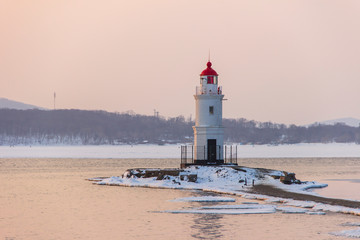 Tokarevsky lighthouse in Vladivostok at dawn on a winter morning.