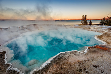 Black Pool at West Thumb Geyser Basin Trail during wonderful colorful sunset, Yellowstone National Park, Wyoming, USA