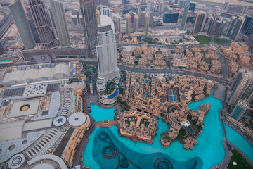 DUBAI, UAE - may 2019: Aerial view of Downtown Dubai with man made lake and skyscrapers from the tallest building in the world, Burj Khalifa, at 828m