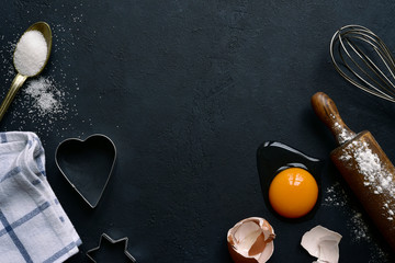 Culinary background with ingredients for baking : sugar, eggs, flour. Top view with copy space.