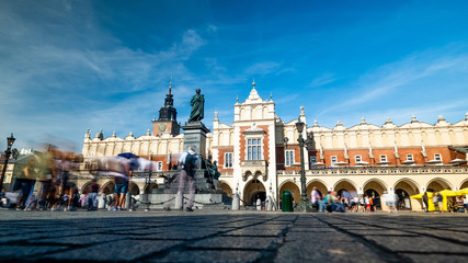 Krakow, Poland, view on the the old town market square and Cloth Hall with blurred pedestrians