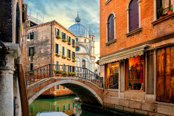 Venice cityscape, water canal, bridge and traditional buildings, Italy. Architecture and landmarks of Venice.