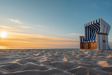 White sand beach and wicker chair on Sylt island