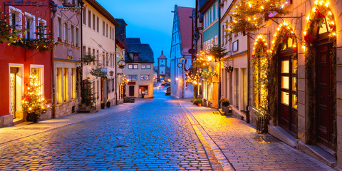 Panoramic view of Christmas street with gate and tower Plonlein in medieval Old Town of Rothenburg ob der Tauber, Bavaria, southern Germany