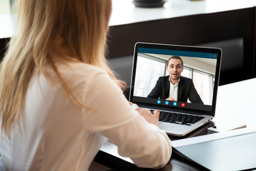 Businesswoman making video call to business partner using laptop, looking at screen with virtual web chat, contacting client by conference, talking on webcam, online consultation, hr concept, close up