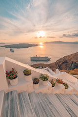 Fira town, with view of caldera, volcano and cruise ships, Santorini, Greece. Cloudy dramatic sky.