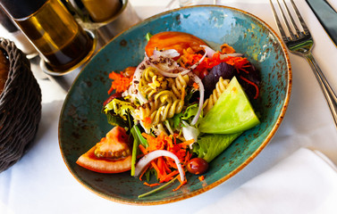 Tasty salad with pasta and vegetables