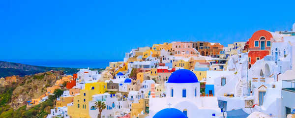 Oia, Santorini, Greece in cyclades island with colorful houses and blue church domes panorama banner