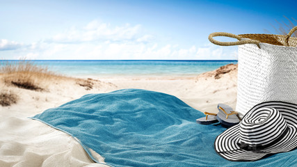 towel on sand and beach background