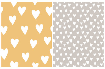 Simple Heart Vector Patterns. Irregular Hand Drawn Pastel Color Romantic Print for Fabric, Textile, Wrapping Paper. White Freehand Hearts Isolated on a Light Yellow and Beige Background.