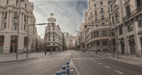 """MADRID, SPAIN - 2 APRIL 2020: The city center """"La gran vía""""  of Madrid (Spain) remains completely empty during the quarantine decreed to combat the covid-19 crisis. Coronavirus pandemic in Europe."""