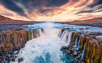 View from flying drone of Selfoss Waterfall. Awesome summer sunrise on Jokulsa a Fjollum river, Jokulsargljufur National Park. Colorful morning scene of Iceland, Europe.