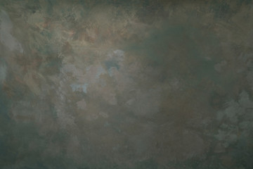 Dark olive coloured artistic canvas backdrop with stains. Abstract vintage texture.