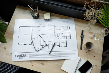 Top view workspace mockup of architectural project with architectural project plan, engineering tools, office supplies and hot coffee cup on wooden desk empty space
