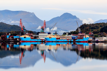 ULSTEINVIK, NORWAY - 2017 SEPTEMBER 18. Modern offshore vessels being built at shipyard Kleven Yard.