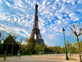 Scenic view of the Eiffel tower with bright blue sky in Paris, France