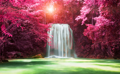 Beautiful waterfall with sunlight in autumn forest at Erawan National Park, Thailand, Nature landscape
