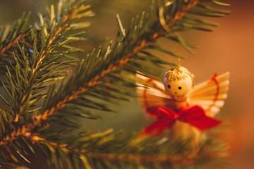 Close-up Of Angel Figurine On Christmas Tree