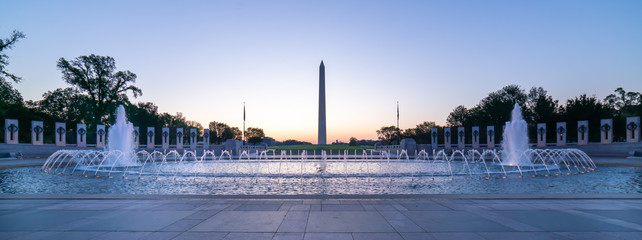 World War Two Memorial. Large angle view of architecture to this famous and landmark monument with George Washington Memorial in background.