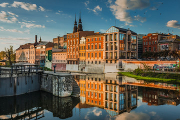 Spring view of city Opole in Silesia in Poland. Historical old town in gold light.