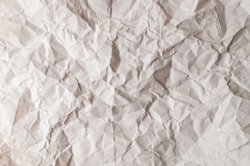Crumpled white paper background.