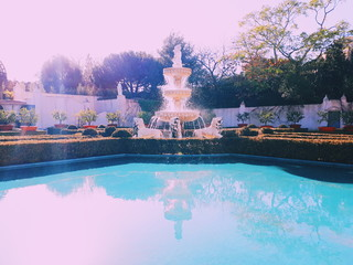Fountain By Swimming Pool Against Sky