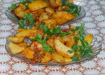 cooked in the oven, potatoes with parsley close-up