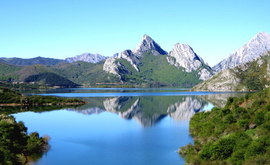 Mountain lake reflection in the reservoir of Riaño