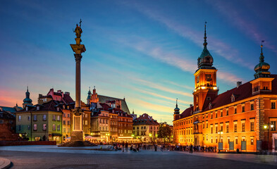 Evening view of the historic center of Warsaw. Panoramic view on Royal Castle, ancient townhouses and Sigismund's Column in Old town in Warsaw, Poland.